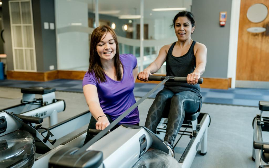 Learner and tutor practical training session with a row machine